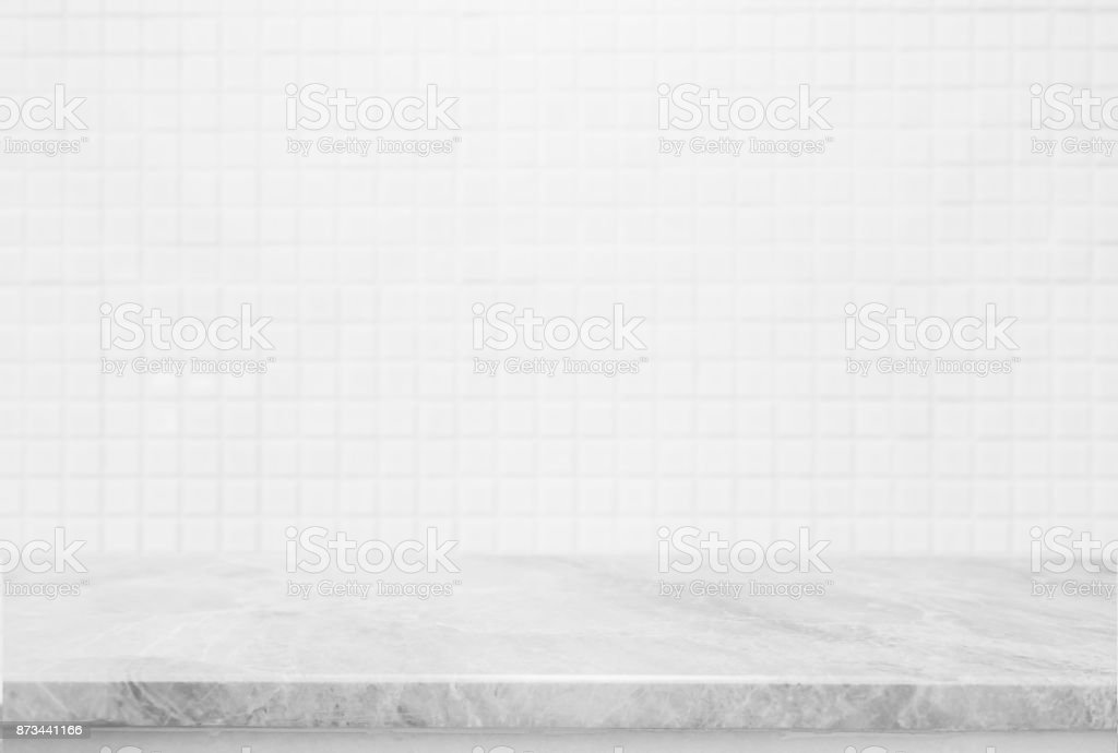 Stone marble table top and background of white ceramic tile wall - can used for display or montage your products. stock photo