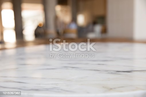 istock Stone marble table top with blur background. 1015267362
