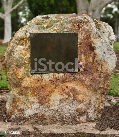 Memorial stone with commemorative plaque or plate.