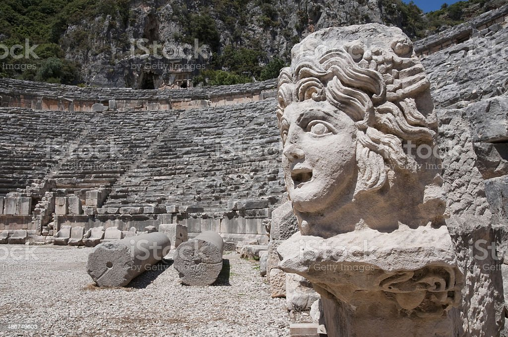 Stone mask and ancient amphitheater, Myra (Turkey) stock photo