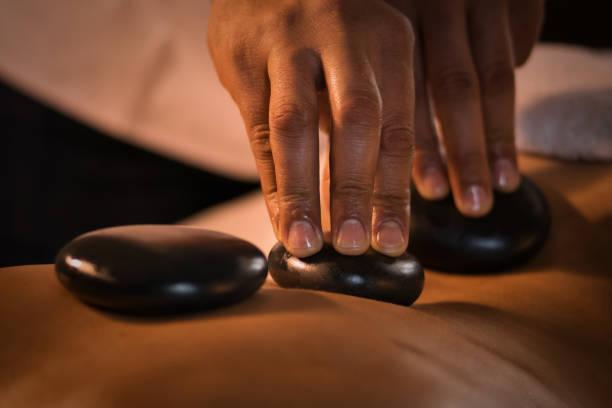 Stone massage closeup stock photo