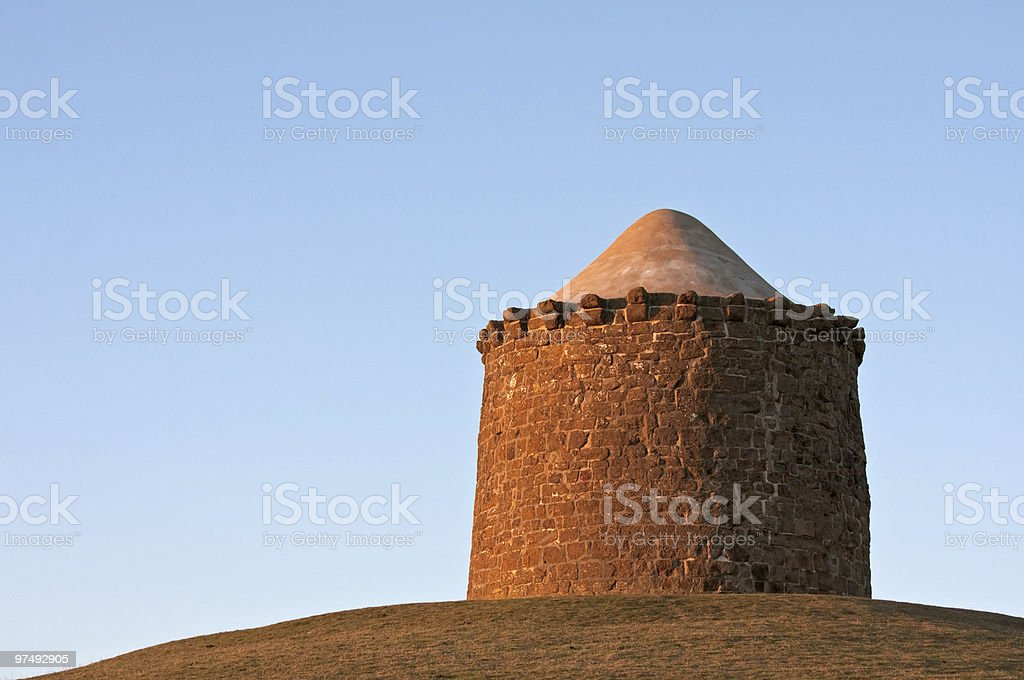 Stone monument on a hilltop royalty-free stock photo