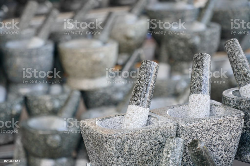 Stone mortar is kitchenware for preparation for cooking food. stock photo