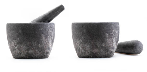 Stone mortar Rustic and coarse appearance. Isolated on white background. Two frontal views. stock photo