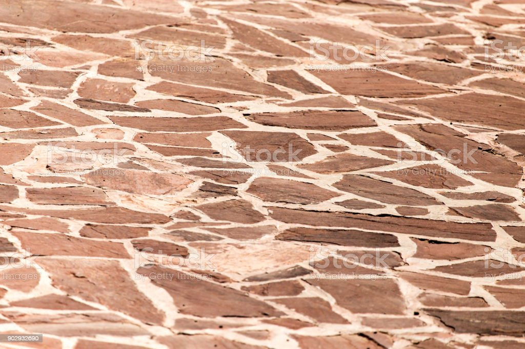 Stone mosaic paving stone as a background stock photo