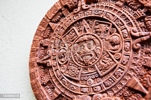 The Aztec calendar stone known as the Stone of the Sun. The original, carved in basalt, was excavated in Mexico City in 1790. This is a modern ceramic reproduction. The stone has become an informal national symbol of Mexico. Shot with EOS 1Ds Mark III.
