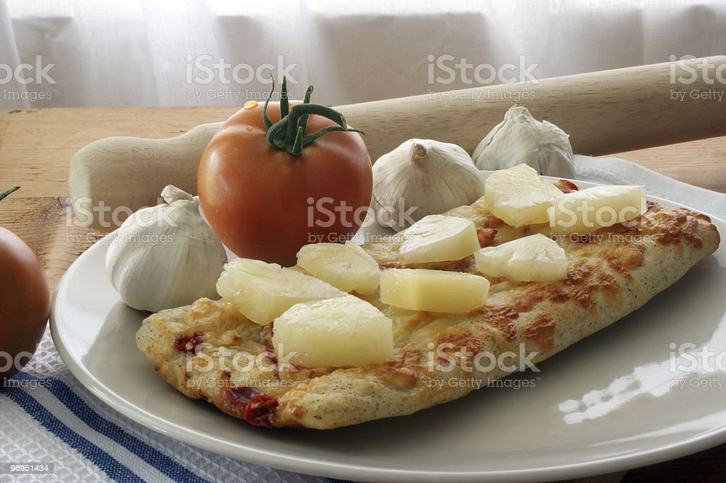stone oven backed pizza with pineapple royalty-free stock photo