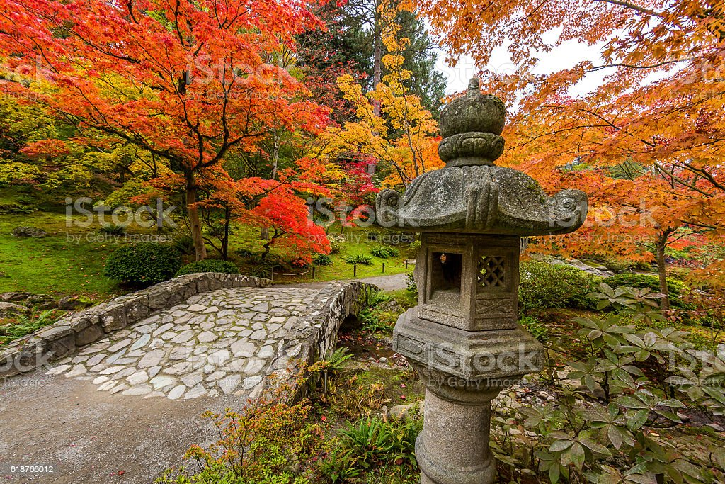 Stone path in the park. Sculpture of a Chinese lantern stock photo