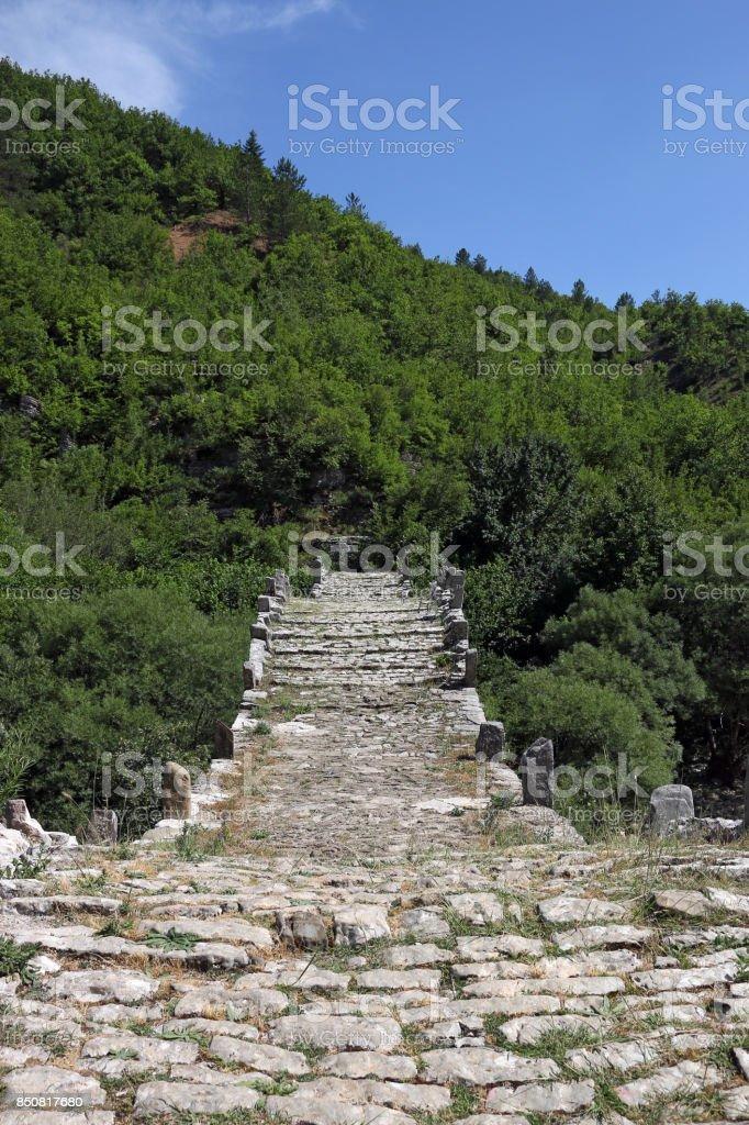 stone path Kalogeriko bridge on Vikos gorge Zagoria stock photo