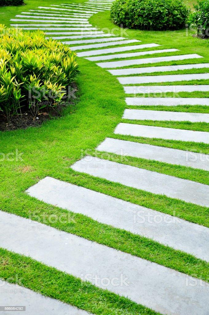 Stone Pathway With Grass In Garden Design Park And Garden Stock