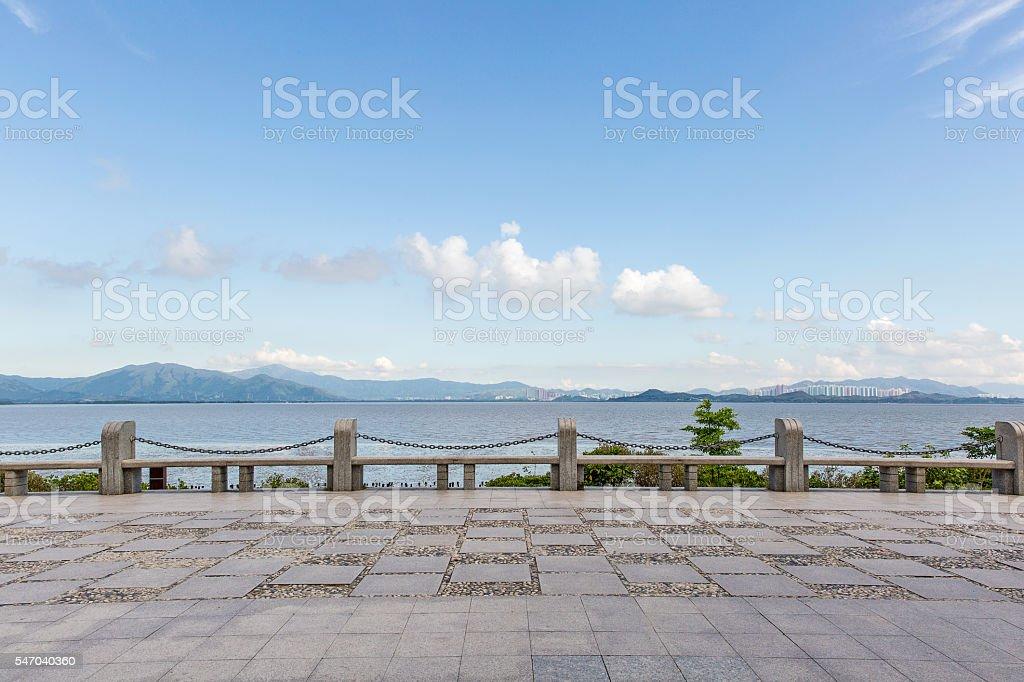 stone pavement at seaside stock photo