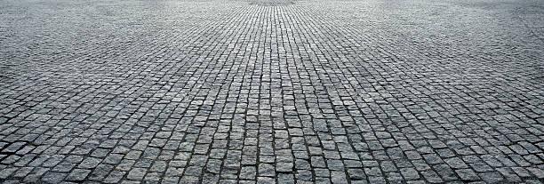 stone pavement in perspective - kaldırım stok fotoğraflar ve resimler