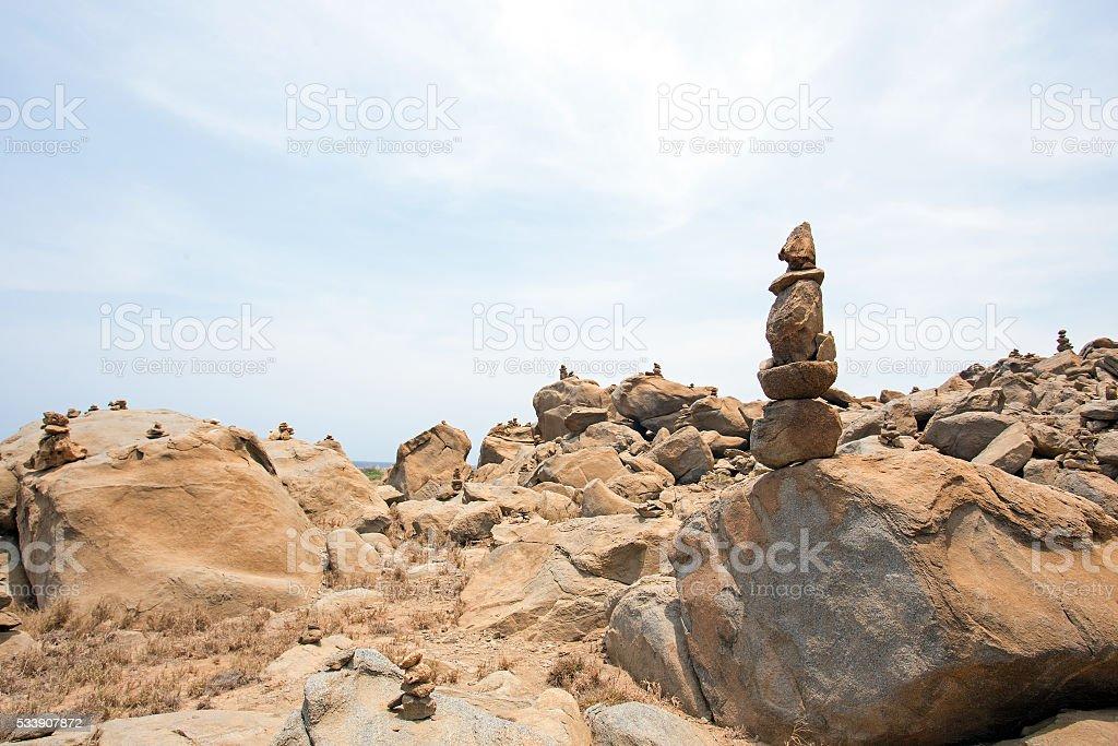 Stone pebbles stacked on the rocks on the beach Aruba stock photo