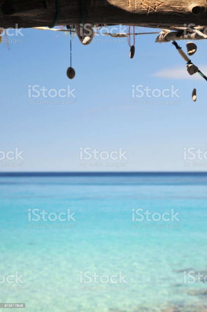 Stone pendants and an ocean stock photo