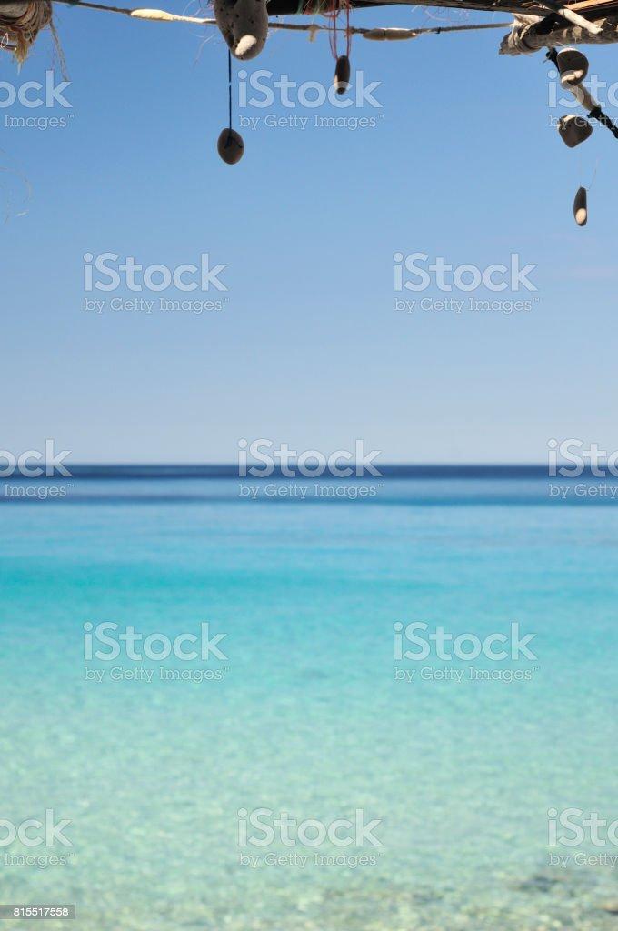 Stone pendants and sea stock photo