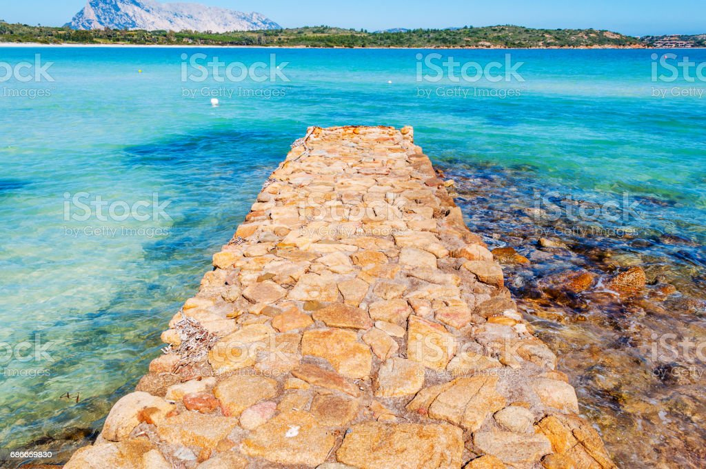 Stone pier in Brandinchi cove royalty-free stock photo