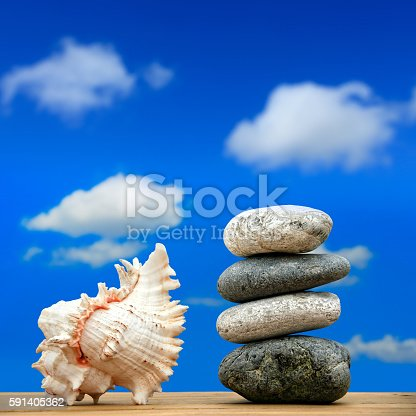591835714 istock photo stone pile on beach 591405362