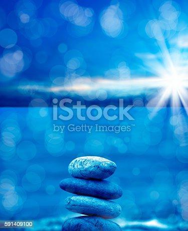 591835714 istock photo stone pile on beach 591409100