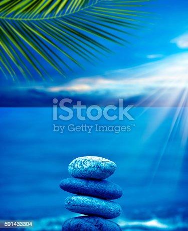 591835714 istock photo stone pile on beach 591433304