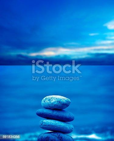 591835714 istock photo stone pile on beach 591834056