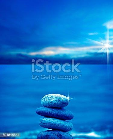 591835714 istock photo stone pile on beach 591845544