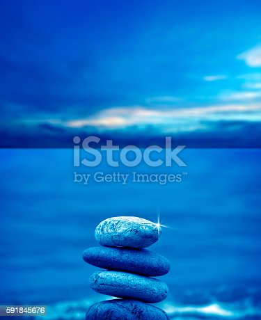 591835714 istock photo stone pile on beach 591845676