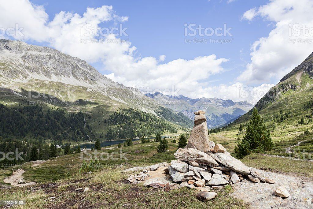 Stone pile with mountain peaks in background. royalty-free stock photo