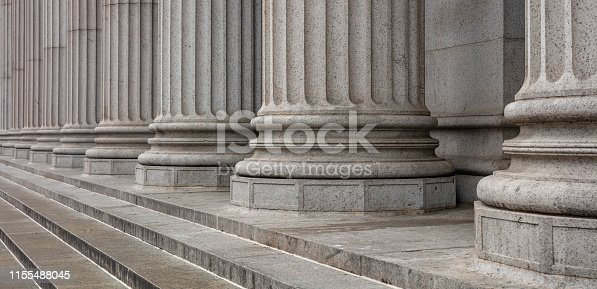 istock Stone pillars row and stairs detail. Classical building facade 1155488045