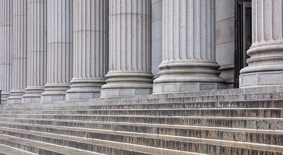 istock Stone pillars row and stairs detail. Classical building facade 1155488047