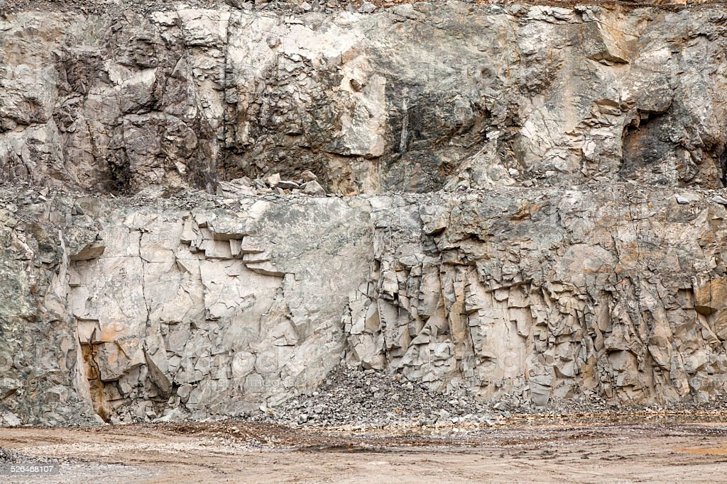 Stone pit wall stock photo