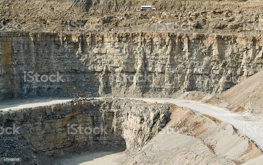 stone pit walls in sunny ambiance stock photo