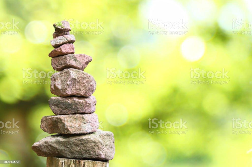 Stone pyramid and bokeh stock photo