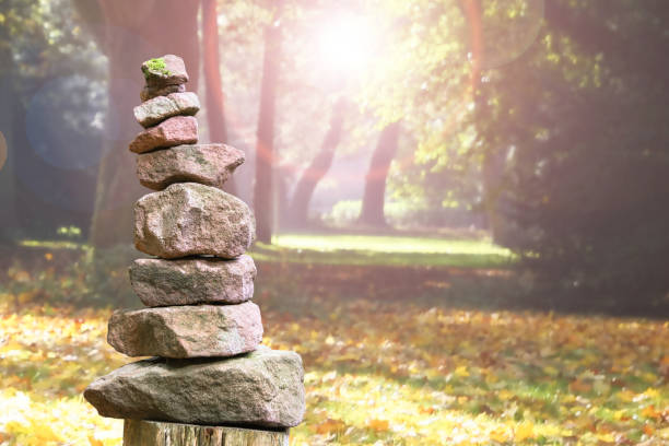 stone pyramid in a park - mindfulness stock photos and pictures