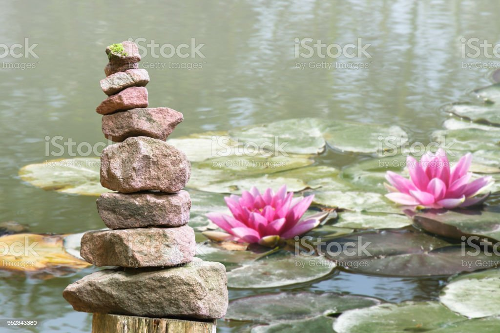 Stone pyramid in the forest stock photo