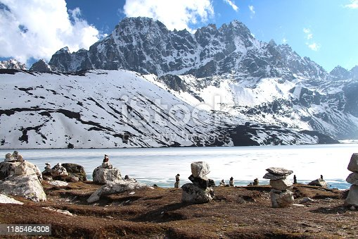 istock Stone pyramids (cairns) on the coast of lake in Himalayas 1185464308