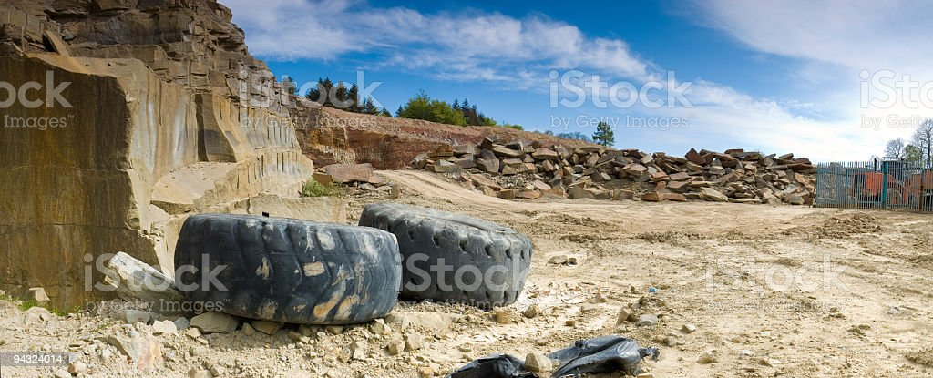 Stone quarry and tractor tyres royalty-free stock photo