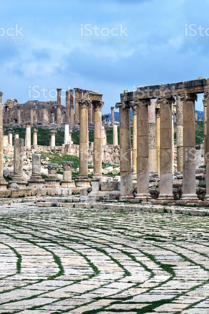 stone road and columns in the ancient roman ruins at the Citadel in amman, jordan - Royalty-free Abandoned Stock Photo