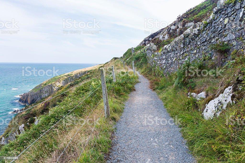 Stone rocks mountain hiking path at Irish seacoast. Bray, Greyst stock photo
