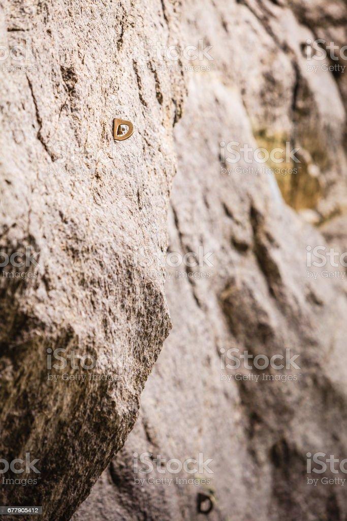 Stone rocks texture with climbing handles royalty-free stock photo