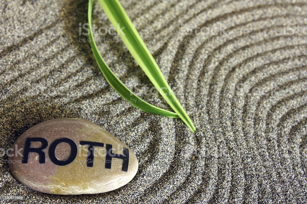A stone saying Roth on top of sand royalty-free stock photo