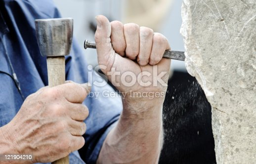 a stone carver at work