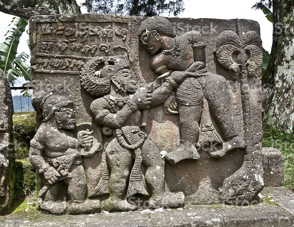 Stone sculpture in ancient erotic Candi Sukuh-Hindu Temple on J royalty-free stock photo