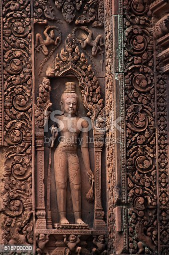 Beautiful detail of stone carving and sculpture on the wall of Banteay Srei temple or the temple of women in Angkor District, Siem Reap Province, Cambodia.(Siem Reap, Cambodia).