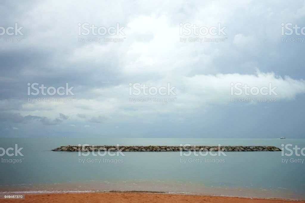 stone sea wave protection stock photo