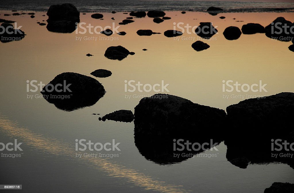 Stone Silhouette Sunset On Water royalty-free stock photo