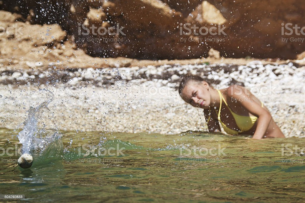 Stone skipping stock photo