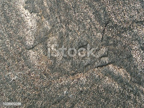 Stone slab, granite, basalt, sandstone, gray and colored as a background - detail shot
