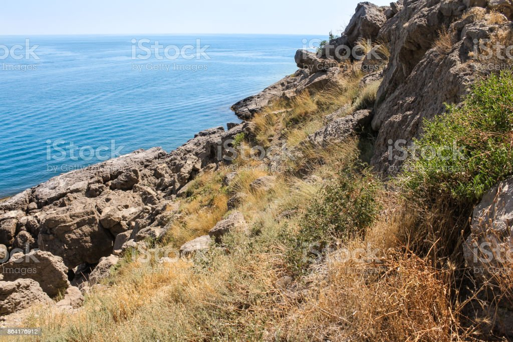 Stone slope to the sea. royalty-free stock photo