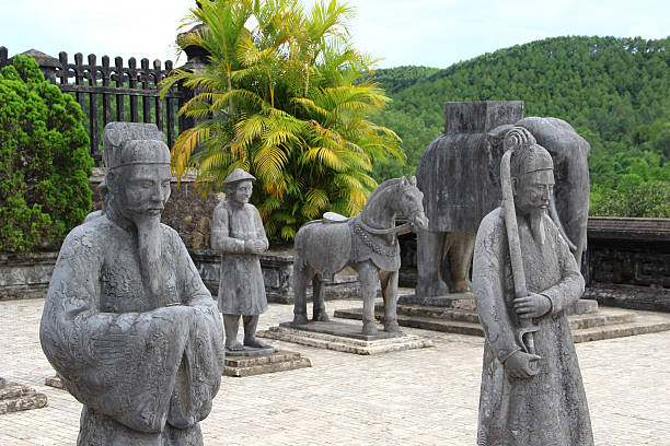 Stone Soldiers II - Hue, Vietnam. On the way to the main tomb of Khải Định hundred of soldier statues are placed as an afterlife escort for the past emperor. khai dinh tomb stock pictures, royalty-free photos & images