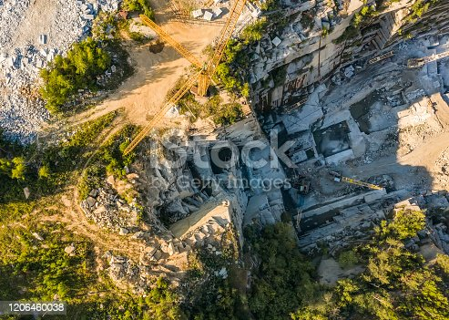 istock Stone sorting conveyor belt in large Quarry - Top down aerial view 1206460038